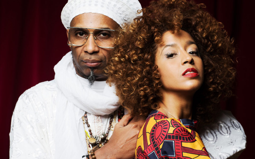 Omar Sosa and Yilian Canizares with red curtain backdrop
