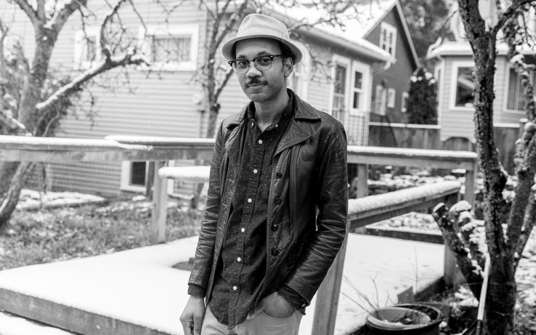 Noel Brass standing in back yard