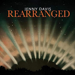 Album cover for Rearranged  by Jenny Davis featuring rays of light emanating from the earth.