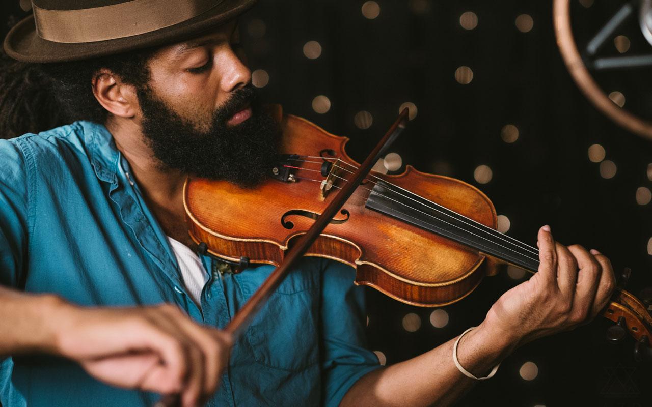Benjamin Hunter playing a violin
