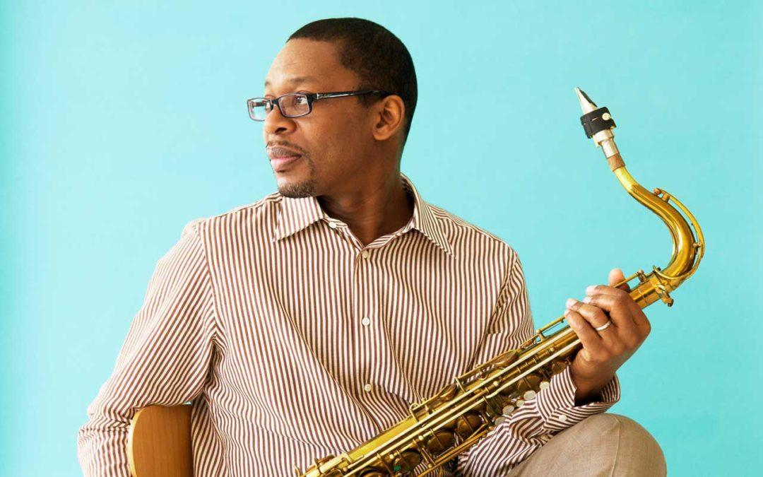 Ravi Coltrane holding a saxphone