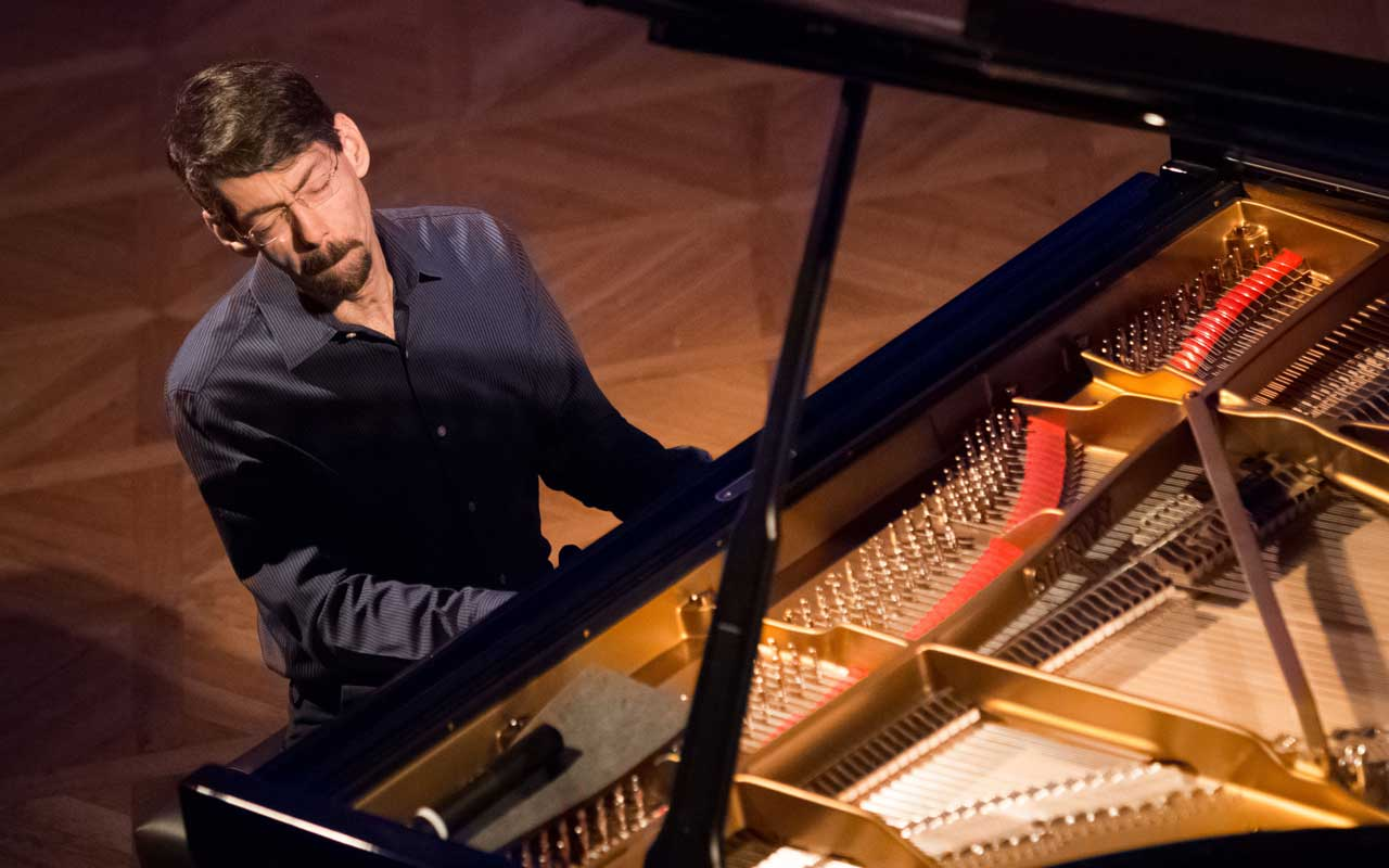 Fred Hersch playing a piano